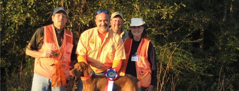 "Luna earns her AKC Junior Hunter Title at a Southern Louisiana Vizsla Club at an American Kennel Club sanctioned Hunt Test on the Neupert Farm in Sunset, Louisiana.  The Neuperts, Ed & Adele, owned Luna's dad Ike - CH Egri I Like Ike, CDX, MH, AX, OAJ, VC, ROM, and also have Luna's ""twin sister"" Carter - CH Egri Vermilion Vlyhtr Carter, JH, NAVHDA NA Prize 1, from the prior pairing of the same parent Vizslas, Ike & Ele - CH Egri Elegans, JH, ROM."